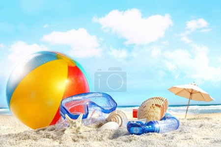 Photo for Fun day at the beach with goggles and beach ball - Royalty Free Image