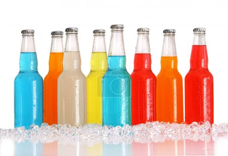 Photo for Bottles of multi-color drinks with ice on white background - Royalty Free Image