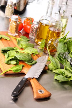 Preparing sinach leaves on cutting board