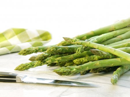 Freshly picked asparagus on white marble