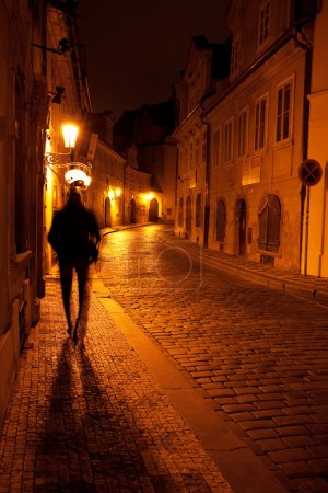 Photo for A beautiful night view of the street and the shadow of a man in Prague - Royalty Free Image