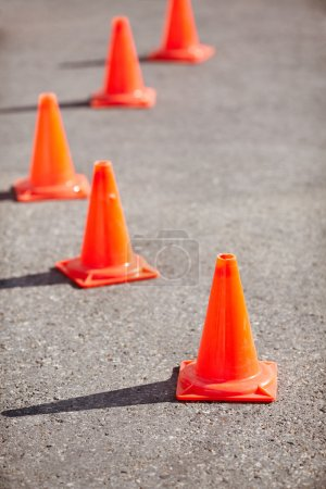 Photo for Erected orange cones mark driving course, selective focus on nearest - Royalty Free Image