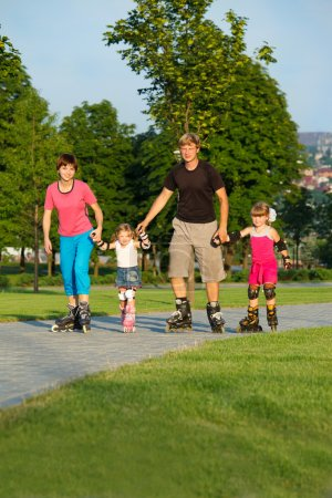 Parents and kids in roller skates