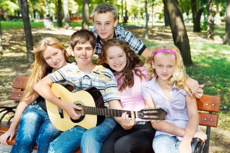 Teens playing guitar