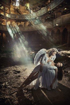 Two beautiful angel women