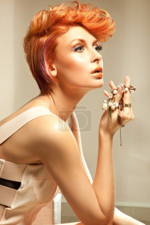 Photo for Young beautiful redhead woman posing with jewellery - Royalty Free Image