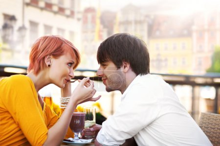 Photo for Cute young couple eating lunch - Royalty Free Image