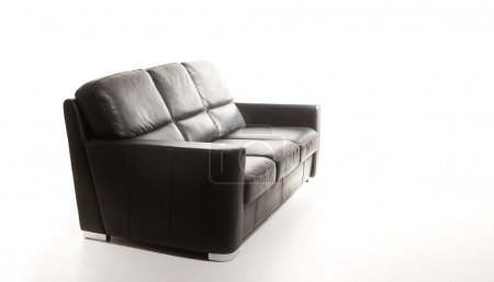 Isolated black couch against white background