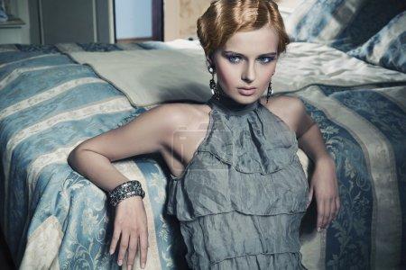 Portrait of a beauty woman in stylish room