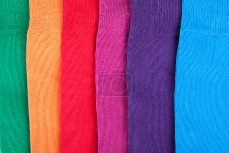 Different color clothes lay in row