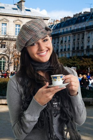 Young woman drink coffee in France