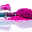Makeup powder of different colors and brush...
