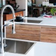 Shiny stainless steel faucet with chrome water tap...