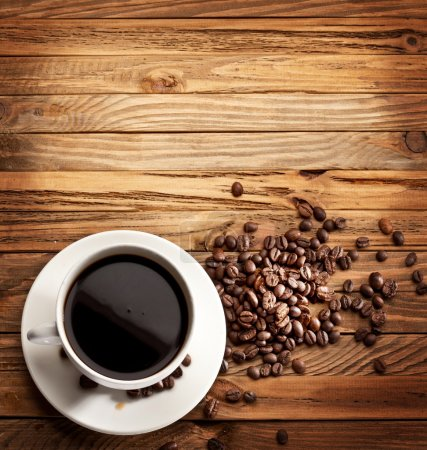 Photo for Cup of coffee. View from above on a wooden surface. - Royalty Free Image