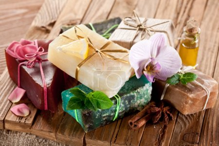Photo for Pieces of natural soap with herbs. - Royalty Free Image