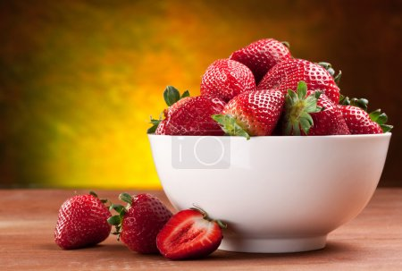 Photo for Appetizing strawberry in the bowl. Isolated on a white background. - Royalty Free Image