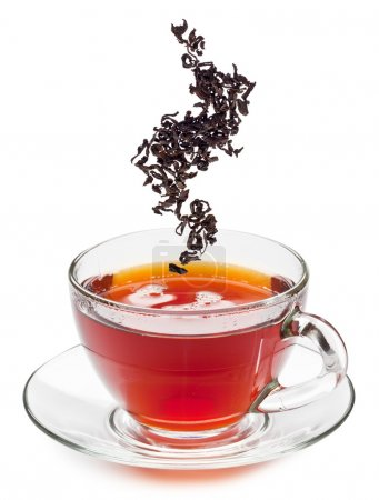 Cup of tea and dry tea leaves.