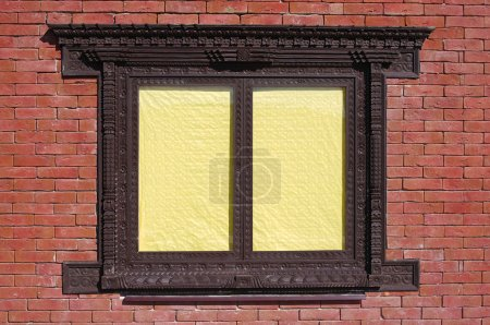 Brick wall and window with yellow blinds