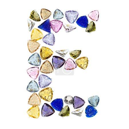 Gemstones alphabet, letter E. Isolated on white background.