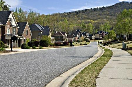 Photo for Sidewalk and street in a beautiful modern nieghborhood. - Royalty Free Image