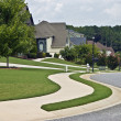 Manicured lawns and curving sidewalks in a modern ...