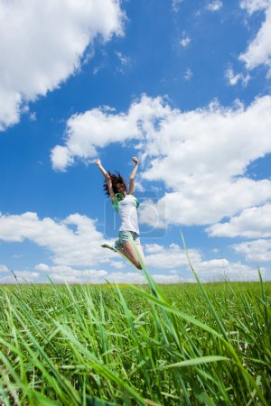 Photo for Happy young woman jump on summer field - Royalty Free Image