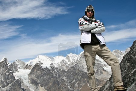Climber standing on the top of Kongma La pass with mountain range of Khumbu