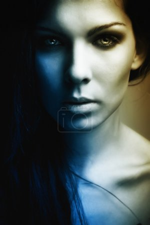 Extravagant beautiful girl dark mystery portrait