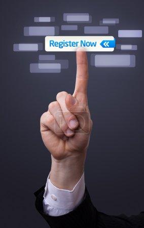 Photo pour Homme main appuyant sur le bouton maintenant registre - image libre de droit