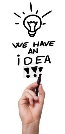 """Photo pour Femme main dessin sur tableau blanc """"nous avons une idée """" - image libre de droit"""