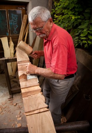 Photo for Old woodcarver working with mallet and chisel 4 - Royalty Free Image