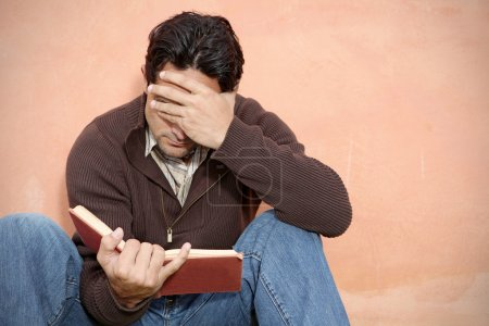 Man reading book or bible