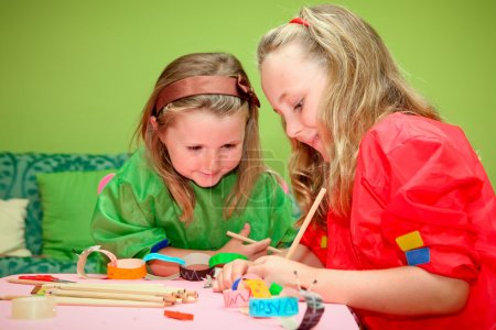 Photo for Happy smiling children playing drawing and making craft in class at kindergarden school - Royalty Free Image