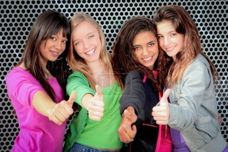 Photo for Happy diverse teen girls showing thumbs up - Royalty Free Image