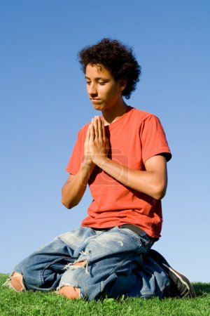 Christianity, teen on knees in prayer
