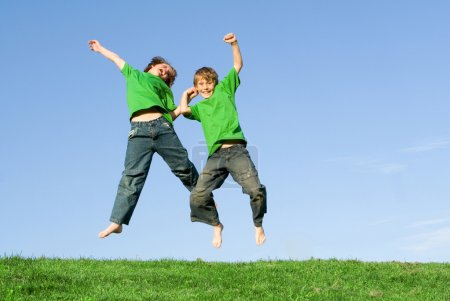 Photo for Happy winning kids jumping in celebration - Royalty Free Image