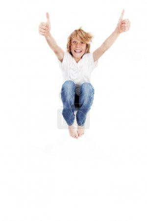 Happy kid jumping, with thumbs up