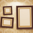 Wooden frames on the wall. Vintage background...