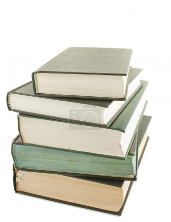 Stack of hard cover books isolated on white