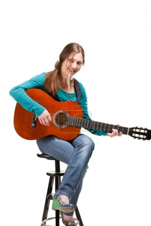 Cowgirl in ahat with acoustic guitar