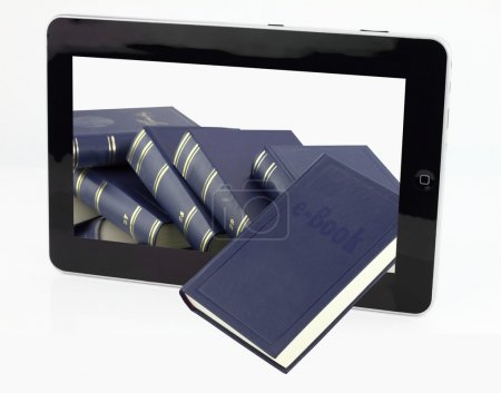 Tablet computer with books isolated on white...