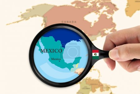 Magnifying glass over a map of Mexico