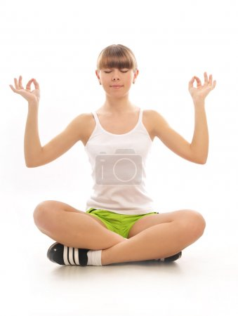 Photo for Young girl meditating in the lotus pose - Royalty Free Image