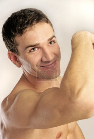 Photo for Man with strong muscles isolated on white - Royalty Free Image