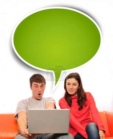 Portrait of a young couple using a computer.