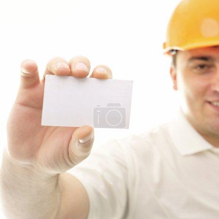Closeup portrait of adult engineer man holding blank business ca