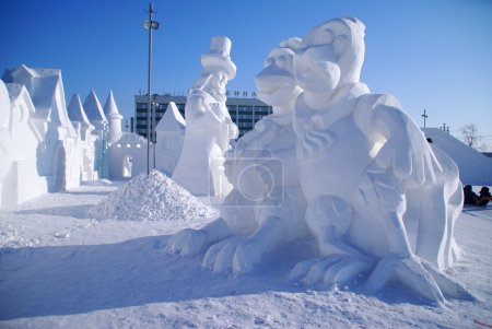 Snow sculpture of two chickens