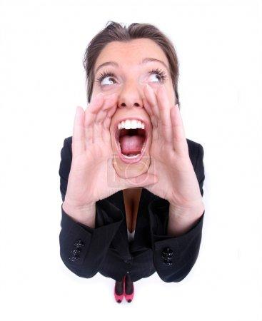Photo pour Un gros plan d'une jeune femme crier sur fond blanc - image libre de droit