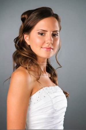 Beautyful girl wearing white dress on the neutral background