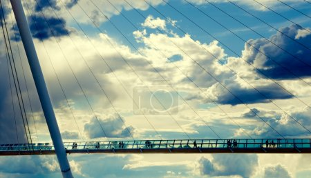 Photo for Modern bridge against the cloudy sky and silhouettes - Royalty Free Image